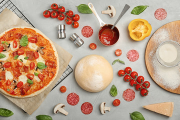 Composition with delicious pizza and ingredients on table, top view
