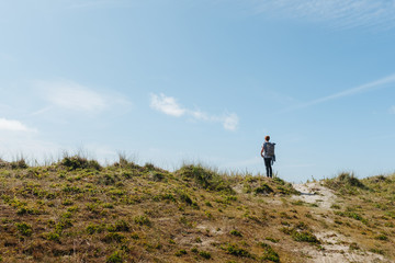 Man on a hike, exporing the dunes