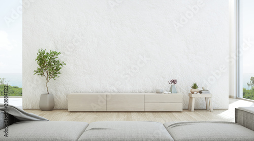 Fototapete Sea view living room of luxury summer beach house with TV stand and wooden cabinet. Empty rough white concrete wall background in vacation home or holiday villa. Hotel interior 3d illustration.