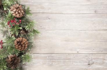 Holiday Christmas pine wreath on wood background