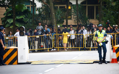 Members of the media wait outside Shangri-la Hotel for the motorcade of U.S. President Donald Trump to leave for his meeting with North Korean leader Kim Jong Un, in Singapore