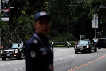 The motorcade of U.S. President Donald Trump travels towards Sentosa for his meeting with North Korean leader Kim Jong Un, in Singapore