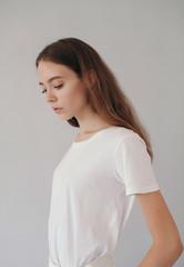 Studio fashion portrait of gorgeous teen girl
