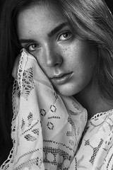 Black and white portrait of a freckled girl