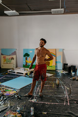 Handsome painter smiling