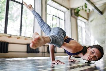 Yogi doing arm balance