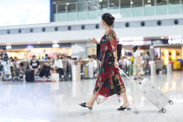 One senior asian woman traveling in airport