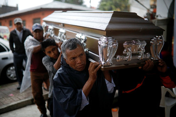 Relatives carry the coffin of Aura Yolanda Perez Paz, 17 who died during the eruption of the Fuego volcano, in Alotenango