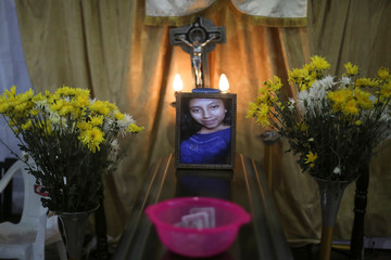 The picture of Aura Yolanda Perez Paz, 17 who died during the eruption of the Fuego volcano, is seen during her wake, in Alotenango