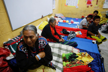 Evacuee family are pictured in a provisional shelter in a local school after the eruption of the Fuego volcano damaged their community in Alotenango