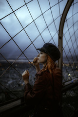 stylish woman enjoying the view from the eiffel tower