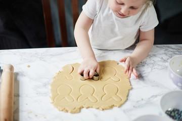 Child baking biscuits
