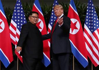 U.S. President Donald Trump greets North Korean leader Kim Jong Un at the Capella Hotel on Sentosa island in Singapore