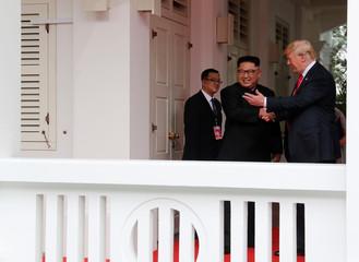 U.S. President Donald Trump shakes hands with North Korea's leader Kim Jong Un at the Capella Hotel in Singapore