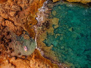 Aerial view with woman resting on the beach, Catalonia, Spain.