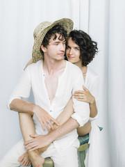 Gentle couple in white posing studio