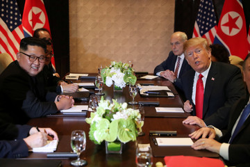 U.S. President Donald Trump is seen with North Korea's leader Kim Jong Un before their expanded bilateral meeting in Singapore