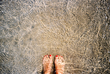Pretty patterns in water of sandy beach, Sicily