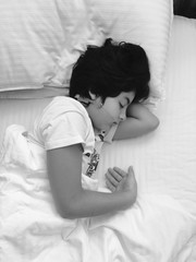 Child with orthodontic sleeping in bed