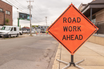 Road work ahead sign on street