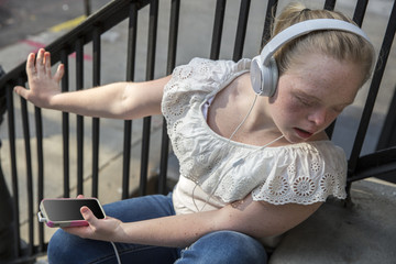 A young adult listening to music