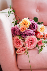 Bouquet of flowers on a pink couch