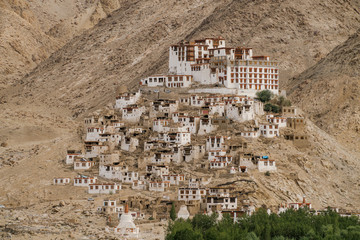Panoramic photo from above of Tibet Buddhism monastery and mountain village at sun light