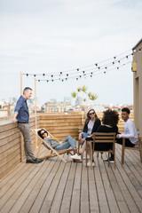 Business teamwork talking in a break moment on a scenic workspace terrace in Barcelona
