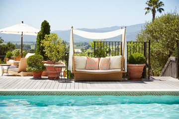 Poolside daybed at luxury resort and spa in Napa Valley, California