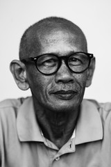Portrait of Asian man wearing glasses