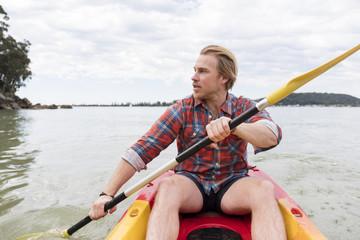 A man paddling his kayak around Ku-ring-gai Chase NP