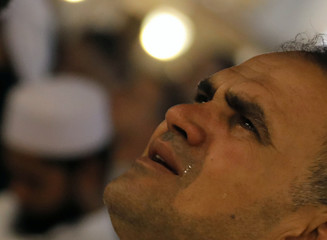 """A muslim takes part in evening prayers called """"Tarawih"""" on Laylat al-Qadr or Night of Decree, during the holy fasting month of Ramadan, at Al Azhar mosque in the old Islamic area of Cairo"""