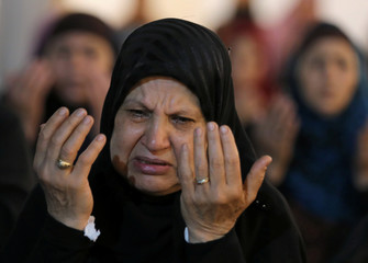 """A woman takes part in evening prayers called """"Tarawih"""" on Laylat al-Qadr or Night of Decree, during the holy fasting month of Ramadan, at Al Azhar mosque in Cairo"""