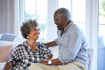African American Senior Couple laughing and having a good time together at home