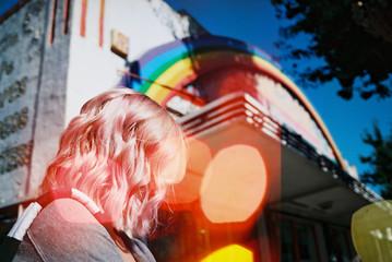 girl with rainbow on street
