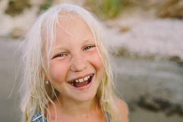 Little blonde girl  laughs