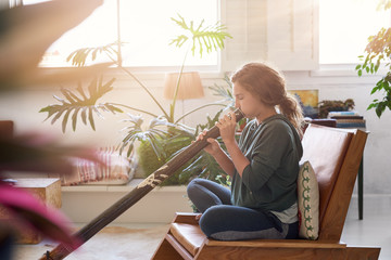 Didgeridoo player at home