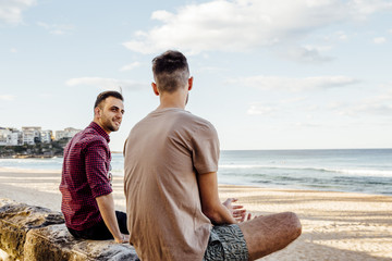 Male Friends at Manly Beach, Australia.