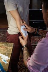 Tattooist applying tattoo drawing