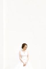 Gentle bride on white background