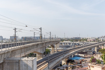 Chennai india may 27 2018 wide view of metro train bridge seen with nearby national highway road (known as kathipaara junction near guindy)