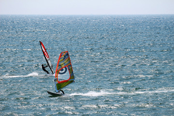 Windsurfing to glide through exhilarating blue sea