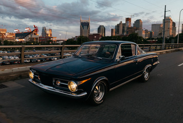 classic car transportation driving across bridge in Nashville Tennessee at sunset