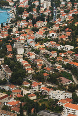 Look from above on Kotor(residence part of the city) with streets and houses and blocks.