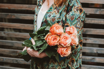 Woman holding orange roses