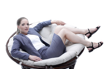 business woman sitting in a round chair rattan