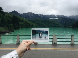 A photo of a photo in front of a lake