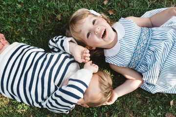 Twin siblings playing on a summer day