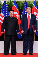 North Korea leader Kim Jong Un and U.S. President Donald Trump stand side by side before their departures after a meeting at the Capella resort, on Sentosa island in Singapore