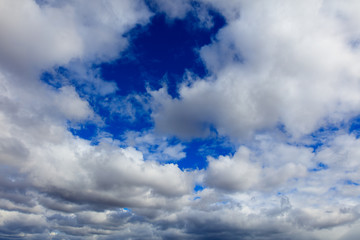 Clouds on a blue sky as a background